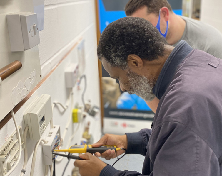 Man training for a career in electrical engineering